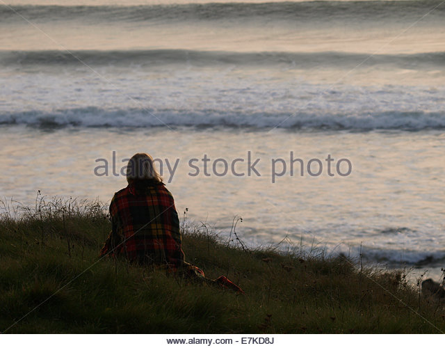 Woman wrapped in a blanket on cliff edge Psalm 27 Comfort Hurt Bible Ignatian Prayer