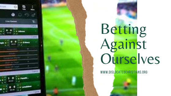 Smart phone betting and football players on pitch
